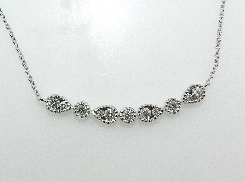 14K white gold diamond necklace; set with eleven G-H SI1 very good cut round brilliant cut diamonds; totaling 0.17 carats.
