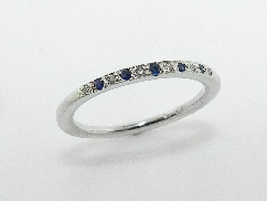 14K white gold sapphire and diamond band set with: - 5 sapphires - 6*=0.031cttw; SI; H/I V. Good cut diamonds
