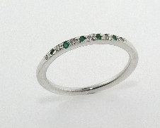 14K white gold emerald and diamond band set with: - 5 emeralds - 6*=0.03cttw; SI; H/I V. Good cut