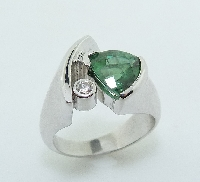 14KW ladies coloured gemstone ring by Studio Tzela set with: - 1.90ct Tourmaline - 0.057 ct; G/H; SI1
