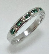 14 karat white gold ladies ring set with: - 6* 0.22 cttw emeralds  - 5* 0.14 cttw excellent cut diamonds F/G; SI1/VS2