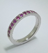 14 karat white gold coloured gemstone band. Set with 13 pink sapphires; 0.362 carat total weight.
