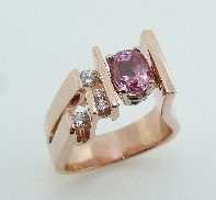 14KR CG ladies ring by Studio Tzela set with: - 1.34ct oval Padparadscha sapphire - 1 RBC x 0.093ct I/J; SI2 - 3 RBC = 0.09 cttw H/I; SI1-2