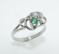 14 KW ladies ring set with: - 0.087 ct round emerald - 0.096 ct round brilliant cut diamond; J; SI2