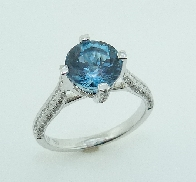18KW lady s CG ring set with: - 2.20ct London blue Topaz - 0.42cttw very good cut; round brilliant cut diamonds; G/H; VS-SI