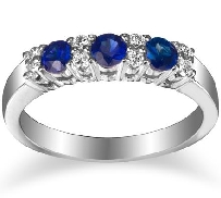 14K white gold sapphire and diamond band set with:   - 8*= 0.12cttw SI1-2 G/H  - 3*= 0.50cttw blue sapphires