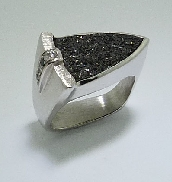 14K white gold ring; set with Druzy Hematite. Accented with two black diamonds; totaling 0.04 carats and two  H-I I1 round brilliant cut diamonds; totaling 0.025 carats.
