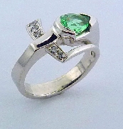 14K white gold ring set with one Cuprian pear-shaped tourmaline. Accented with side diamonds; 0.095 carat total weight; H SI1-2.