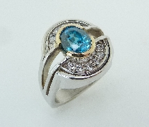 14K White and Yellow Gold Ring set with a 3.17ct Blue Zircon. Accented with VS2-SI1; G-H ideal round brilliant cut diamonds by Hearts On Fire; totaling 0.384 carat.