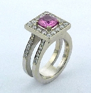 14 karat white gold coloured gemstone ring by Studio Tzela. Set with a 1.444 carat Pink Sapphire. Accented with 16 diamonds; 0.574ctw and 28 diamonds; 0.20 carat total weight; SI-VS; G/H.