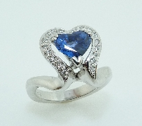 14K white gold engagement ring set with:  - 1.63ct heart sapphire - 18*-1.2mm = 0.131ct exc cut SI1 F/G