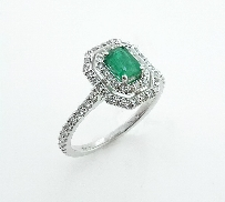 14K white gold engagement ring set with: - 0.442ct emerald - 62*=0.374cttw SI1-2; v.good - exc cut diamonds