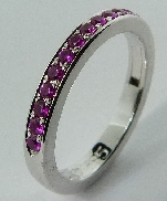 14K white gold ring; set with mardi grass pink sapphire; totaling 0.35 carats. Size 6