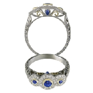 14 karat white gold coloured gemstone ring by Rainbow Sapphire. Hand engraved and set with Blue Sapphires; 1.16 carat total weight. Accented with 0.024 carat total weight of Diamonds.   Hand engraved 14KT  t-t gold ring; bezel set with diamond cu