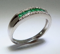 14 karat white gold coloured gemstone band. Set with 7 emeralds; 0.30 carat total weight. Accented with 24 diamonds; 0.09 carat total weight.