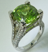 14 karat white gold coloured gemstone ring. Set witha 7.82 carat Peridot. Accented with 114 diamonds; 1.00 carat total weight; G/H; SI/I.