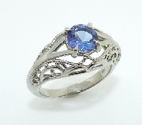 14KW vintage lady s ring set with: - 1.105ct round tanzanite
