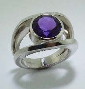 14K White gold ring; set with one 3.58ct  round Amethyst.
