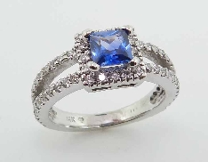 14 K white gold lady s ring set with: - 0.76ct sapphire; princess cut - 64 round brilliant cut diamonds; 0.72cttw; GH; SI1-2