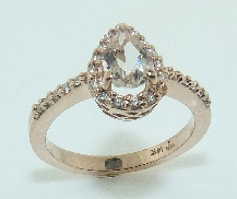 14K rose gold ring set with:  - 0.60ct morganite pear - 26*-0.144ct excellent cut diamonds