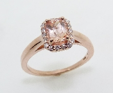 14 KR ladies ring set with: - 0.83 ct natural peach sapphire - 18 round brilliant cut diamonds; 0.135 cttw; G/H; SI1-2