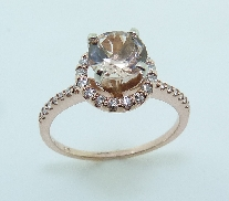 14KR CG lady s ring set with: - 0.715 ct Morganite - 0.198 cttw round brilliant cut diamonds; 0.198 cttw