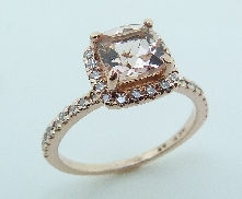 14KR CG lady s ring set with: - 0.972ct Morganite  - 0.285cttw round brilliant cut diamonds