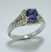 14 karat white gold coloured gemstone ring.  Set with 0.95 carat Tanzanite. Accented with diamonds;0.50 carat total wegith; SI-VS; G-H.