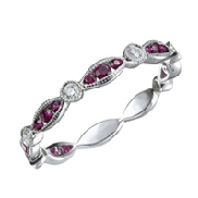 14K white gold ladies band set with: -21 rubies totalling 0.41 carats -6 diamonds totalling 0.13 carats