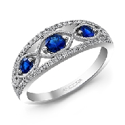 14KW CG lady s band set with: - 52 RBC diamonds; 0.19cttw; G/H; SI very good cut - 3 sapphires; 0.50cttw