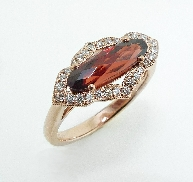 14KR CG lady s ring set with: - Oval garnet; 1.75ct  - 28 RBC diamonds; 0.18cttw; G/H; SI very good cut