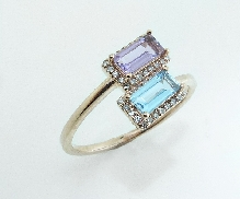 14KR CG lady s ring set with: - 44 RBC diamonds; 0.17cttw; G/H; SI very good cut  - amethyst baguette; 0.33ct - blue topaz baguette; 0.38ct