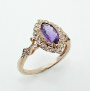 14KR CG lady s ring set with: - 22 RBC diamonds; 0.19cttw; G/ H; SI very good cut - marquis amethyst; 0.87ct