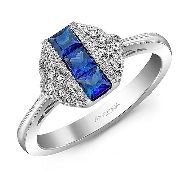 14K white gold ring set with:   - 12*= 0.06cttw  - 3*= 0.54cttw sapphires