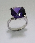 14 karat white gold coloured gemstone ring. Set with a 7.8 carat Amethyst. Accented with diamonds; 0.316 carat total weight.