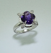 14K white gold ring; set with one 3.13ct cushion cut Amethyst. Accented with eleven round brilliant cut diamonds; totalling 0.08 carat.