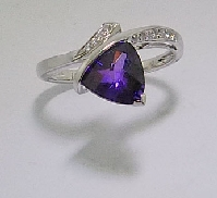 14 karat white gold coloured gemstone ring. Set with 1.55 carat Amethyst. Accented with diamonds; 0.078 carat total weight.