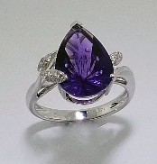 14 karat white gold coloured gemstone ring. Set with 3.75 carat Amethyst. Accented with diamonds; 0.108 carat total weight.