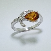 14 karat white gold  ring. Set with aone1.21 carat pear shape Citrine. Accented with diamonds; totaling 0.166 carat.