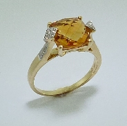 14 karat yellow gold gemstone ring. Set with one 3.39 carat cushion cut Citrine. Accented with diamonds; totaling 0.105 carat.