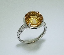 14 karat white gold coloured gemstone ring. Set with a 4.60 carat round Citrine.