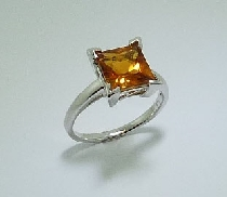 14 karat white gold ring; set with one 2.20 carat princess cut citrine.