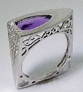 14 karat white gold coloured gemstone ring.  Set with one 1.75 carats triangle shaped amethyst.  Accented with thirty nine  SI-VS; G-H round brilliant cut  diamonds totaling 0.229 carats.