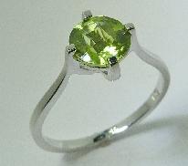 14 karat white gold coloured gemstone ring. Set with a 1.4 carat Peridot.