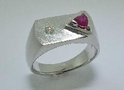 14 karat white gold Mens Ring by Studio Tzela set with: - 0.345 carat Trillion cut Ruby  - 0.052 carat round brillant cut diamond; I1