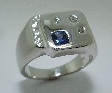 14 karat white gold mens ring by Studio Tzela set with: - 0.343 carat cushion cut sapphire - 3 = 0.08 carat diamonds G/H; SI