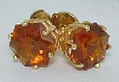 14 karat yellow gold coloured gemstone earrings by Studio Tzela. Set with 2 Star of David Citrines. With locking backs.