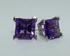 14k White gold earrings; set with square step cut amethyst.