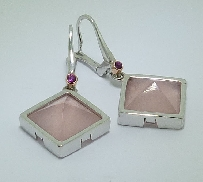 14K white gold coloured gemstone earrings. Set with two pink quartz pyramid cabachons; totaling 13.68 carats. Accented with two pink sapphires; totaling 0.065 carats.