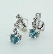 14KW Studio Tzela CG earrings set with: - 2 blue zircon; 0.771cttw  - 4 RBC diamonds; 0.10cttw SI1-2